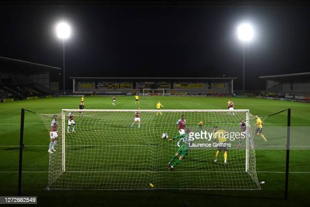 Colin Daniel of Burton Albion scores his team's first goal during the Carabao Cup Second Round match between Burton Albion and Aston Villa at Pirelli...