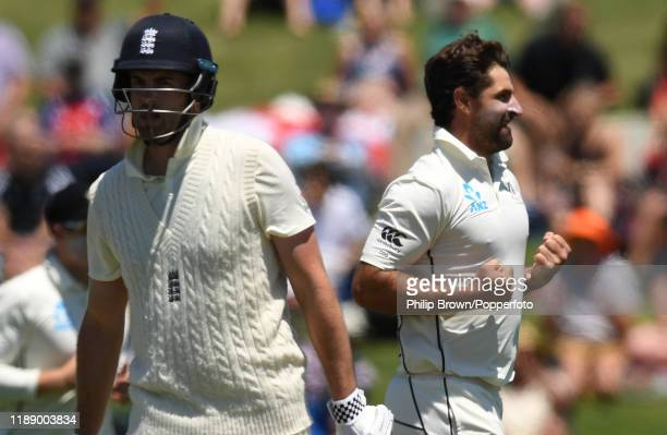 Colin de Grandhomme of New Zealand celebrates after dismissing Dom Sibley of England during day one of the first Test match between New Zealand and...