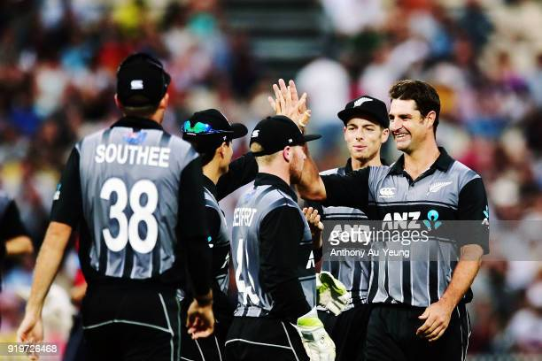 Colin de Grandhomme of New Zealand celebrates with teammates for the wicket of Dawid Malan of England during the International Twenty20 match between...