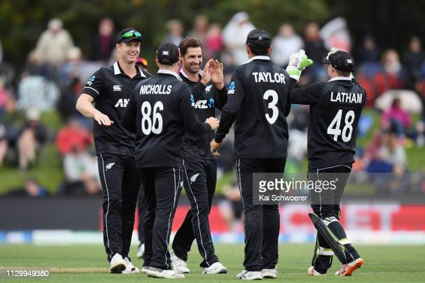 Colin de Grandhomme of New Zealand is congratulated by team mates after dismissing Soumya Sarkar of Bangladesh during Game 2 of the One Day...