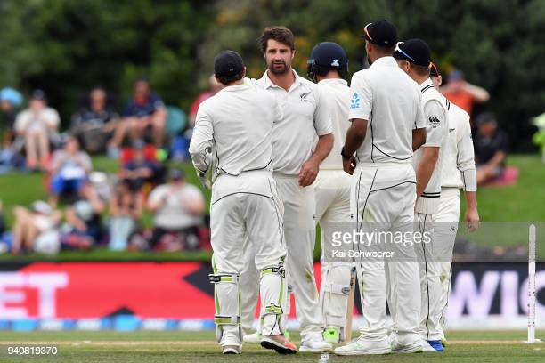 Colin de Grandhomme of New Zealand is congratulated by team mates after dismissing Stuart Broad of England during day four of the Second Test match...