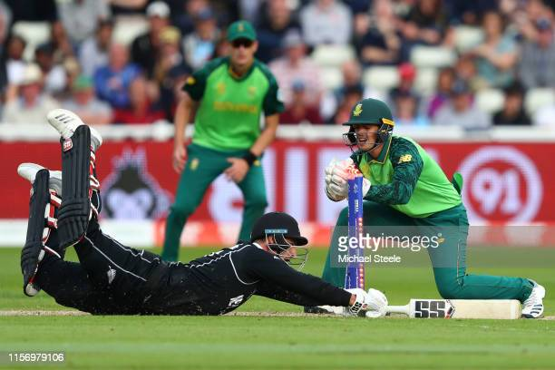 Colin de Grandhomme of New Zealand makes his ground as wicketkeeper Quinton de Kock gathers the ball during the Group Stage match of the ICC Cricket...