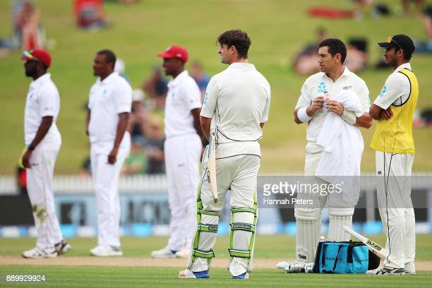 Colin de Grandhomme of New Zealand waits for the third umpire to rule on a lbw during day three of the Second Test Match between New Zealand and the...