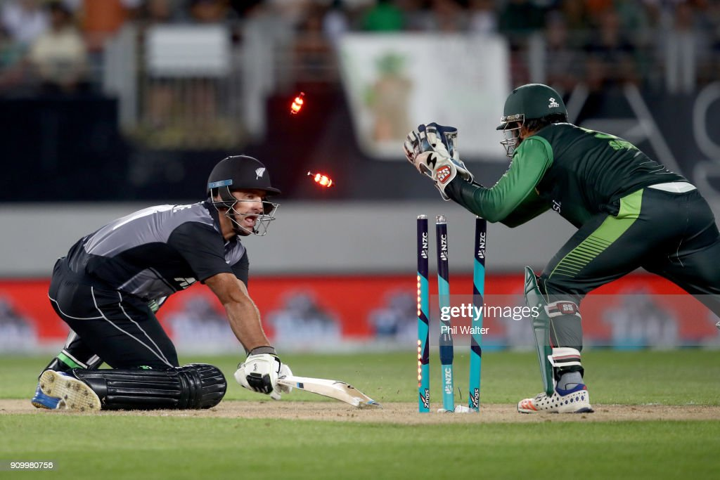 Colin de Grandhomme of the Blackcaps is stumped by Sarfraz Ahmed of Pakistan during the International Twenty20 match between New Zealand and Pakistan at Eden Park on January 25, 2018 in Auckland, New Zealand.