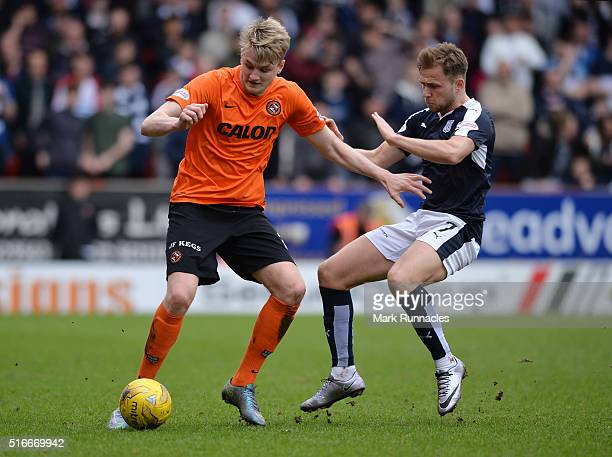 Colin Donaldson of Dundee United is tackled by Greg Stewart of Dundee during the Ladbrokes Scottish Premiership match between Dundee United FC and...