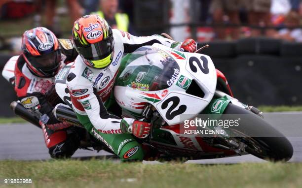 Colin Edwards from the United States leans into Dingle Dell corner closely followed by Noriuki Haga during the second race of the World Superbikes...