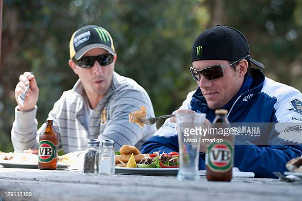 Colin Edwards of USA and Monster Yamaha Tech 3 and Ben Spies of USA and Yamaha Factory Racing eat during the preevent 'Trout fishing' prior to the...