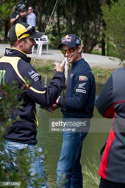 R Colin Edwards of USA and Monster Yamaha Tech 3 and Casey Stoner of Australia and Repsol Honda Team fishing the trouts during the preevent 'Trout...