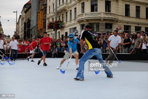 Colin Edwards of USA and Monster Yamaha Tech 3 and Chris Vermeulen of Australia and Rizla Suzuki MotoGP take part in the preevent Floorball Match...