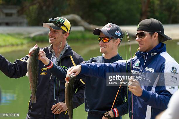 Colin Edwards of USA and Monster Yamaha Tech 3 Casey Stoner of Australia and Repsol Honda Team and Ben Spies of USA and Yamaha Factory Racing pose...