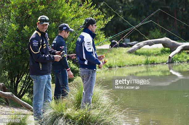 Colin Edwards of USA and Monster Yamaha Tech 3 Casey Stoner of Australia and Repsol Honda Team and Ben Spies of USA and Yamaha Factory Racing fishing...