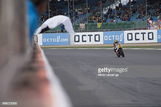 Colin Edwards of USA cuts the finish lane during the Barry Sheene Parade during the MotoGp Of Great Britain Race at Silverstone Circuit on September...