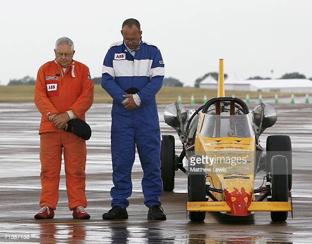 Colin Fallows of Northampton and Mark Newby of Oxford pay their respects stood next to the afterburning jet car 'Split Second' to the 'July 7th...