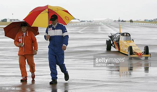 Colin Fallows of Northampton and Mark Newby of Oxford walk away from the afterburning jet car 'Split Second', as rain halters the attempt to break...