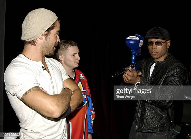 Colin Farrell and LL Cool J during Cast Members of SWAT Stop by MTV's TRL August 7 2003 at MTV Studios Times Square in New York City New York United...