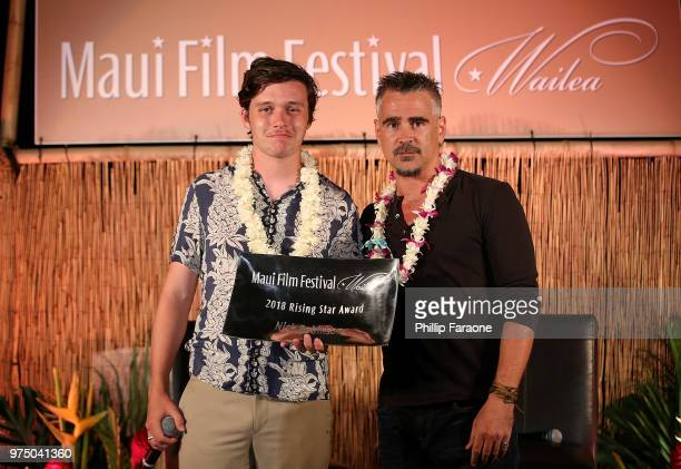 Colin Farrell presents the Rising Star Award to Nick Robinson at the 2018 Maui Film Festival on June 14 2018 in Wailea Hawaii