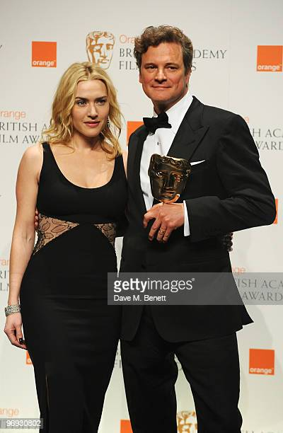 Colin Firth poses with the Best Actor Award for A Single Man presented by Kate Winslet during the The Orange British Academy Film Awards 2010 at The...