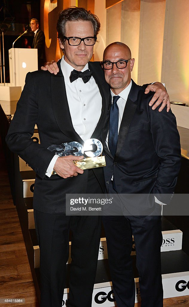 Colin Firth (L), winner of the Leading Man award, and presenter Stanley Tucci attend the GQ Men Of The Year awards in association with Hugo Boss at The Royal Opera House on September 2, 2014 in London, England.