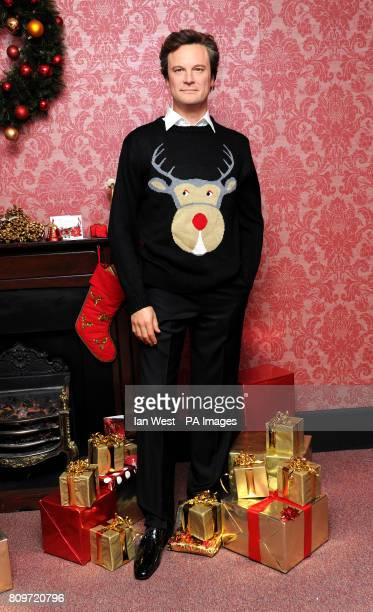 Colin Firth's waxwork wears a Christmas jumper at Madame Tussauds in London