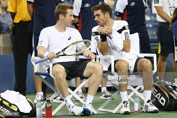 Colin Fleming and Jonathan Marray of Great Britain confer while playing Bob and Mike Bryan on Day Eight of the 2013 US Open at USTA Billie Jean King...