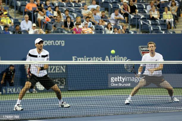 Colin Fleming and Jonathan Marray of Great Britain play Bob and Mike Bryan on Day Eight of the 2013 US Open at USTA Billie Jean King National Tennis...