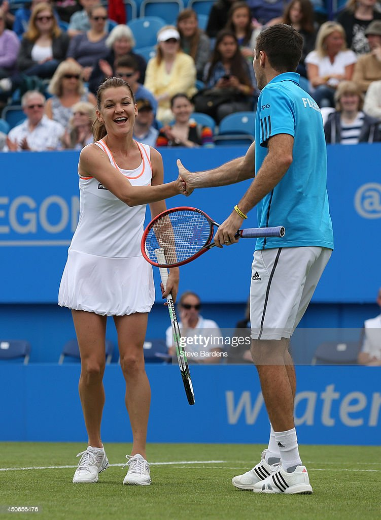 Colin Fleming of Great Britain and Agnieszka Radwanska of Poland celebrate a point during the Rally for Bally mixed doubles charity match on day two of the Aegon International at Devonshire Park on June 15, 2014 in Eastbourne, England.