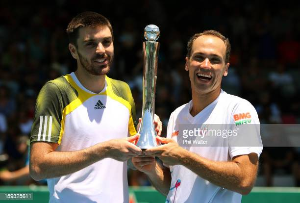 Colin Fleming of Great Britain and Bruno Soares of Brazil hold the trophy following their doubles final against Johan Brunstrom of Sweden and...