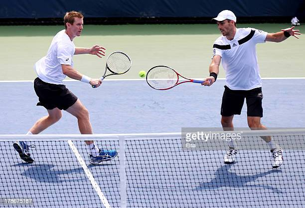 Colin Fleming of Great Britain and Jonathan Marray of Great Britain in action during their men's doubles second round match against Ryan Harrison of...