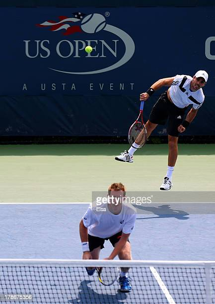 Colin Fleming of Great Britain serves next to his partner Jonathan Marray of Great Britain during their men's doubles second round match against Ryan...