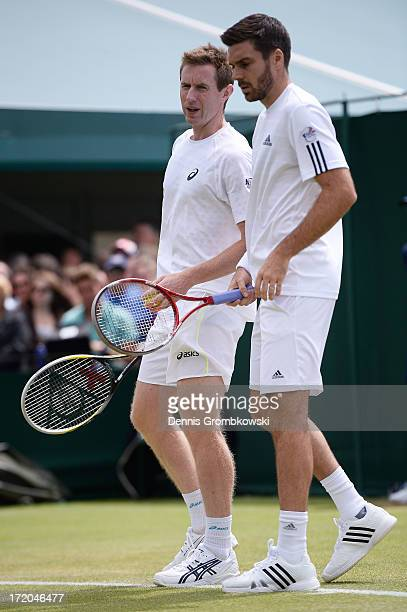 Colin Fleming of Great Britain talks tactics with teammate Jonathan Marray of Great Britain during their Gentlemen's Doubles third round match...