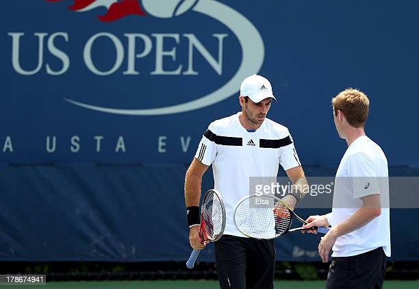Colin Fleming of Great Britain taps hands with his partner Jonathan Marray of Great Britain during their men's doubles second round match against...