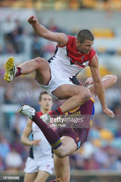 Colin Garland of the Demons attempts a mark during the round five AFL match between the Brisbane Lions and the Melbourne Demons at The Gabba on April...