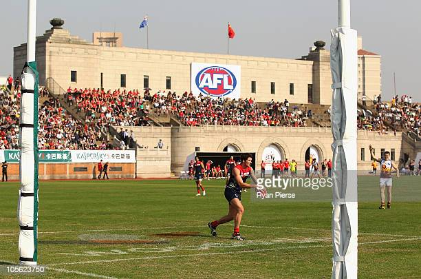 Colin Garland of the Demons kicks out during the AFL Kaspersky Cup Shanghai Showdown match between the Brisbane Lions and the Melbourne Demons at...