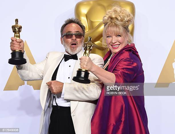 Colin Gibson and Lisa Thompson pose with their Oscar for Best Production Design Mad Max Fury Road in the press room during the 88th Oscars in...