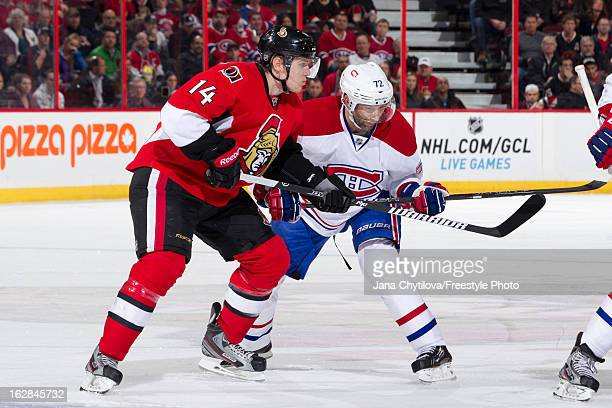 Colin Greening of the Ottawa Senators battles for position against Erik Cole of the Montreal Canadiens, during an NHL game, at Scotiabank Place on...