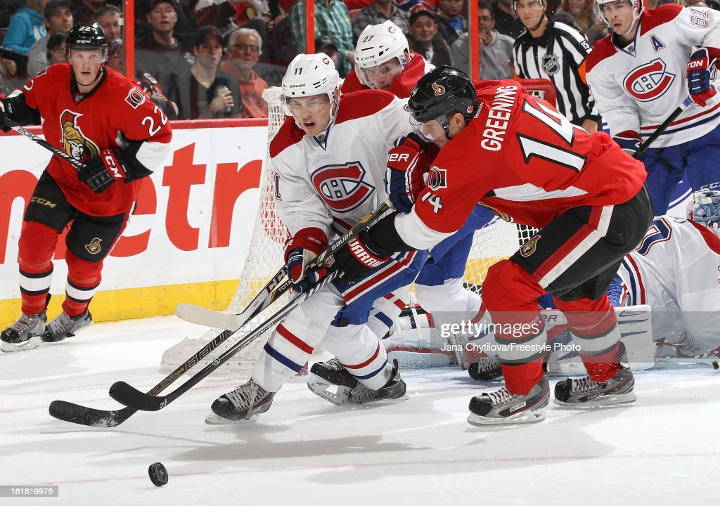Colin Greening #14 of the Ottawa Senators battles for the puck against Brendan Gallagher #11 and Alex Galchenyuk #27 of the Montreal Canadiens during an NHL pre-season game at Canadian Tire Centre on September 25, 2013 in Ottawa, Ontario, Canada.