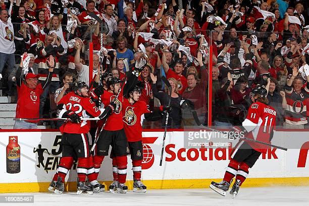 Colin Greening of the Ottawa Senators celebrates his gamewinning goal with teammates Erik Condra JeanGabriel Pageau and Daniel Alfredsson against the...