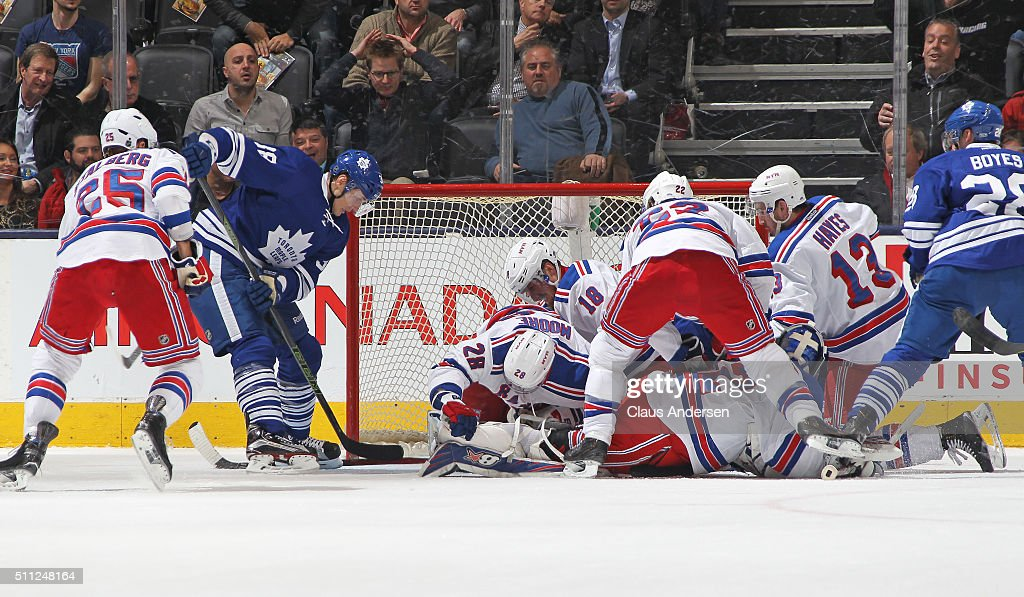 Colin Greening #38 of the Toronto Maple Leafs scores his 1st goal as a Maple Leaf against Antti Raanta #32 of the New York Rangers during an NHL game at the Air Canada Centre on February 18, 2016 in Toronto, Ontario, Canada. The Rangers defeated the Maple Leafs 4-2.