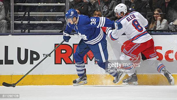 Colin Greening of the Toronto Maple Leafs tries to elude the checking Kevin Klein of the New York Rangers during an NHL game at the Air Canada Centre...