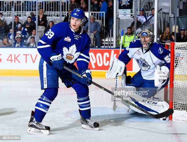 Colin Greening of the Toronto Marlies puts a screen on goalie Mike McKenna of the Syracuse Crunch during game 4 action in the Division Final of the...