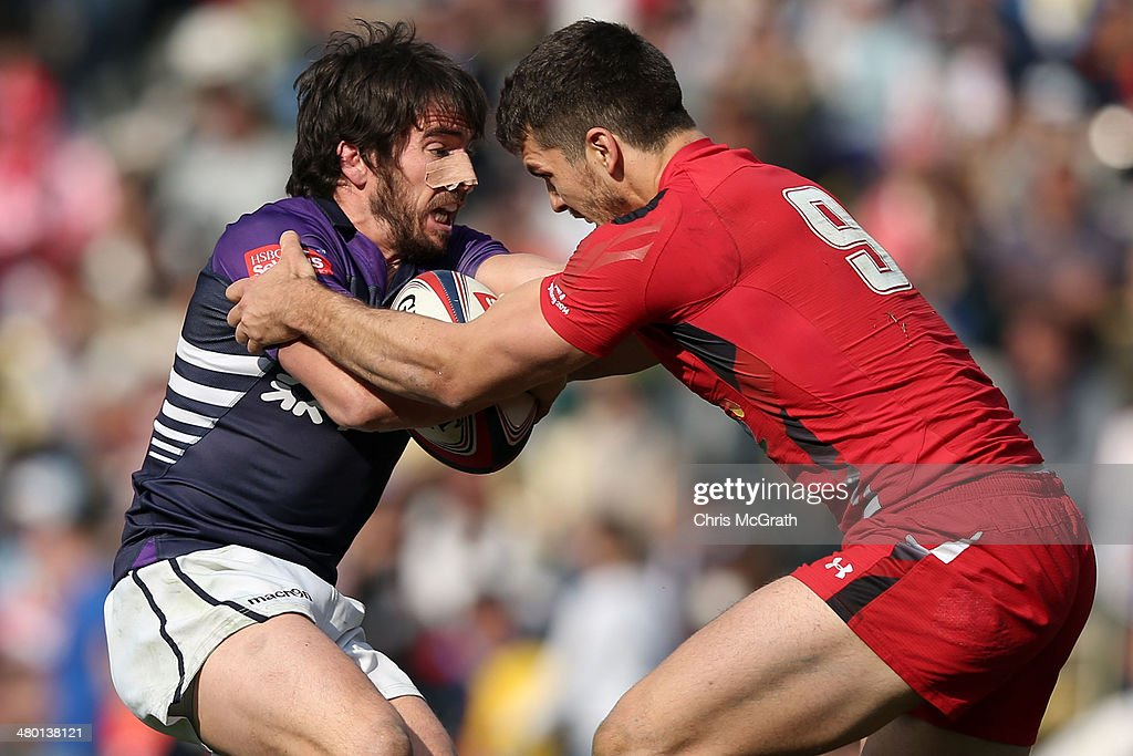Colin Gregor #5 of Scotland is tackled by Will Price #9 of Wales during Bowl Final at the Tokyo Sevens, in the six round of the HSBC Sevens World Series at the Prince Chichibu Memorial Ground on March 23, 2014 in Tokyo, Japan.
