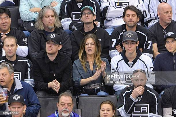 Colin Hanks Rita Wilson and Truman Theodore Hanks attend a hockey game between the Chicago Blackhawks and the Los Angeles Kings at Staples Center on...