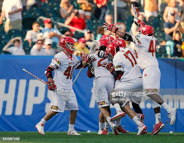 Colin Heacock of the Maryland Terrapins is mobbed by teammates after his game winning goal in overtime for a 1514 win over the Brown Bears during a...