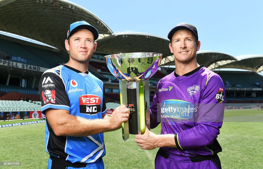 Colin Ingram captain of the Adelaide Strikers and George Bailey captain of the Hobart Hurricanes with BBL cup during the Big Bash League Final media opportunity at Adelaide Oval on February 3, 2018 in Adelaide, Australia.