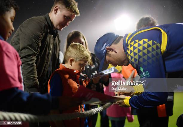 Colin Ingram of Glamorgan signs autographs for young fans following the Vitality Blast match between Glamorgan and Surrey at Sophia Gardens on August...