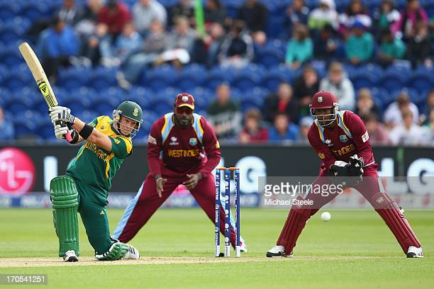 Colin Ingram of South Africa hits through the offside as wicketkeeper Johnson Charles of West Indies looks on during the ICC Champions Trophy Group B...