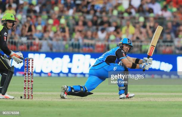 Colin Ingram of the Strikers bats during the Big Bash League match between the Sydney Thunder and the Adelaide Strikers at Spotless Stadium on...
