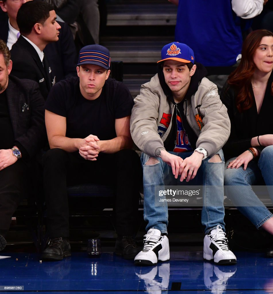 Colin Jost and Pete Davidson attend the New York Knicks Vs Boston Celtics game at Madison Square Garden on December 21, 2017 in New York City.