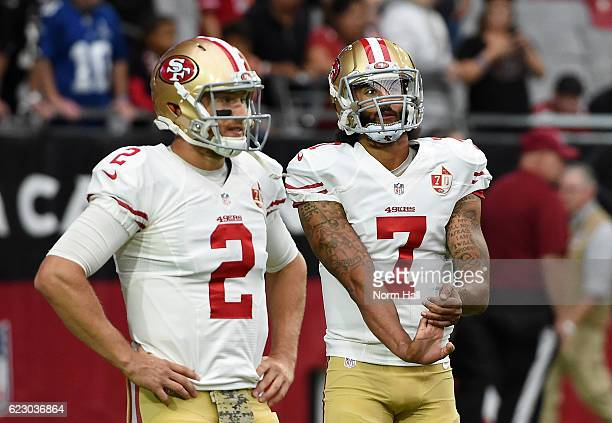 Colin Kaepernick and Blaine Gabbert of the San Francisco 49ers warm up prior to a game against the Arizona Cardinals at University of Phoenix Stadium...