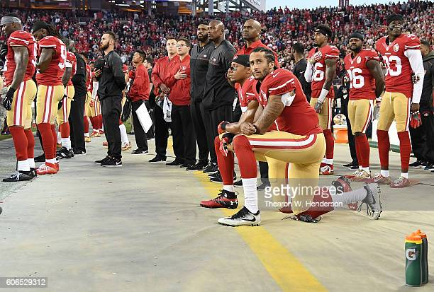 Colin Kaepernick and Eric Reid of the San Francisco 49ers kneel in protest during the national anthem prior to playing the Los Angeles Rams in their...